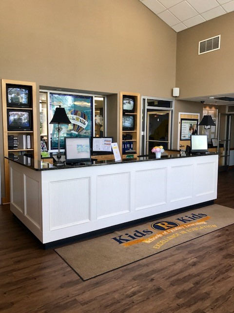"Entry Lobby & Front Desk, ""Welcome to Kids 'R' Kids!"""