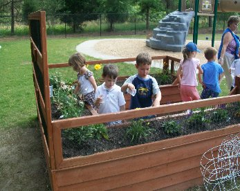 Our students love to be in our outdoor classroom that includes raised garden beds.